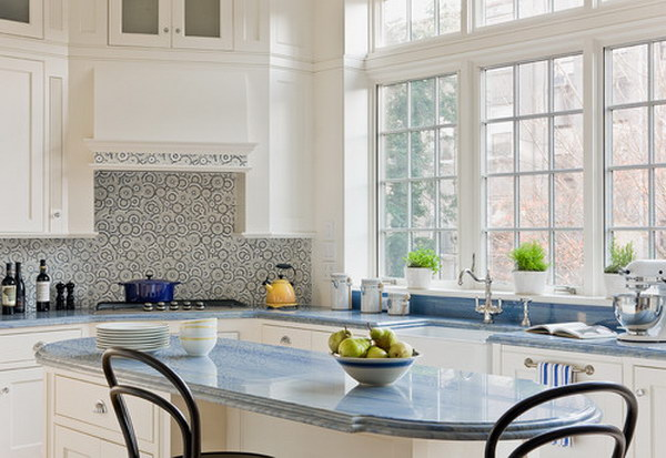 Lovely White Kitchen Cabinets With Cute Mosiac Tile Backsplash And Blue Countertop .