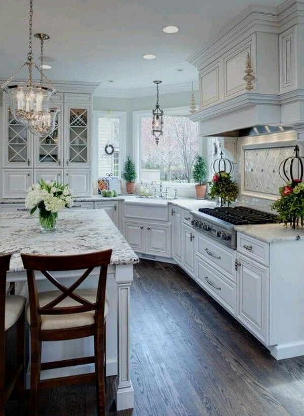 White Transitional Kitchen With Snow White Granite Countertops.