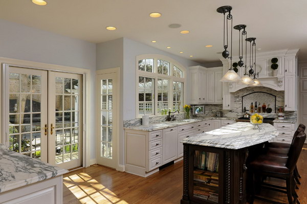 Stunning White Kitchen With Marble Countertops.