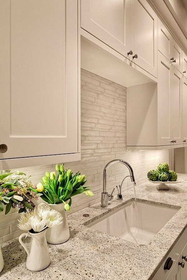 Kashmir White Granite Countertops with White Cabinets.