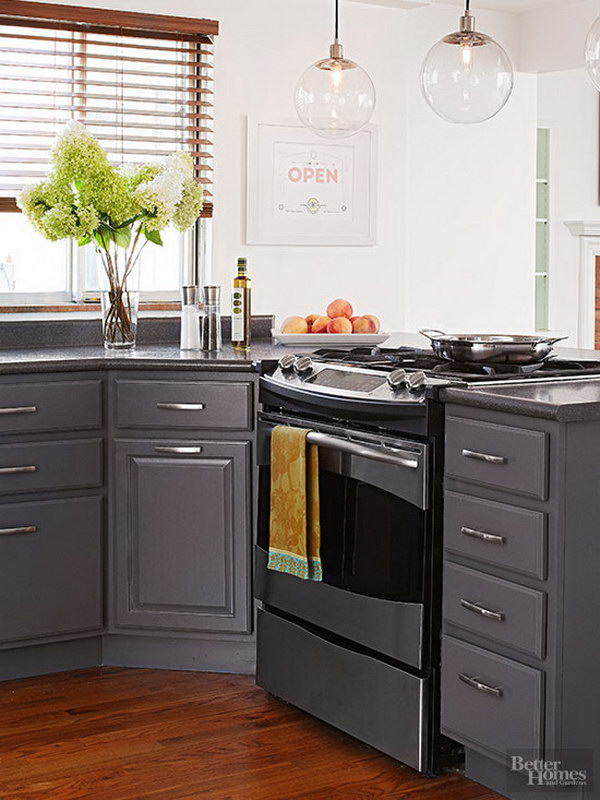 Slate Gray Cabinets with Crisp White Walls and Sleek Silver Finishes