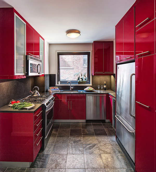 Contemporary U shaped Enclosed Kitchen with Flat panel Red Cabinets.