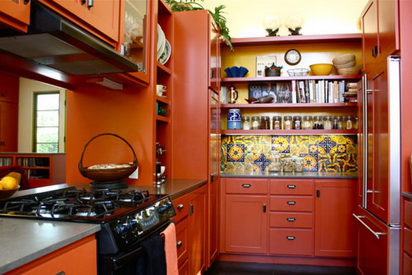 Rich Red Orange Open Cabinets With Multicolored Backsplash And Paneled Appliances.