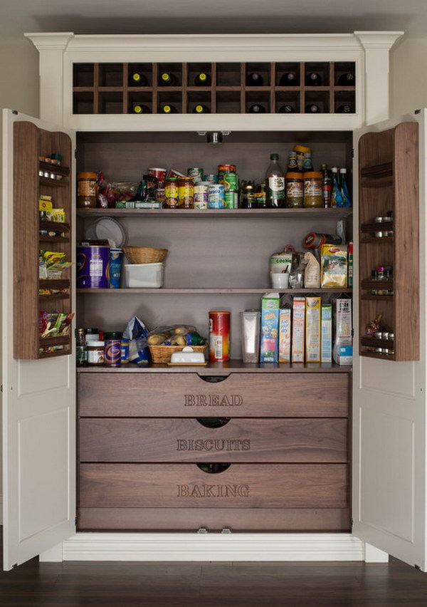 Built in Pantry with Labeled Wood Drawers and the Wine Rack at The Top.