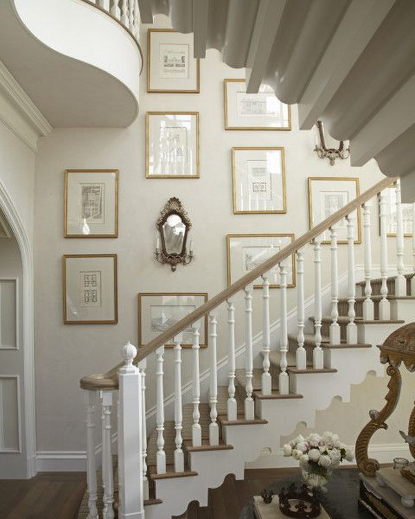 elegant and beautiful way to place prints on wall going up the stairs.