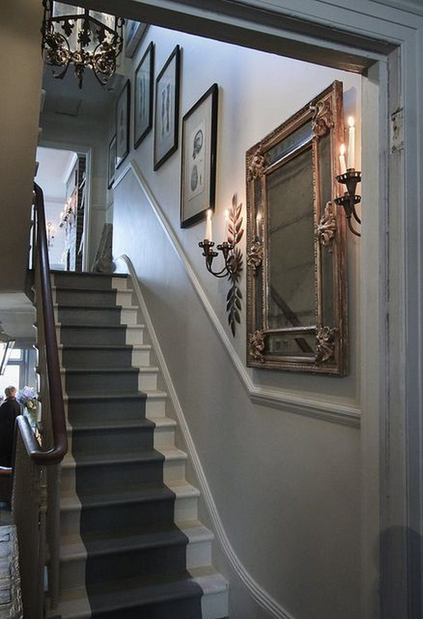 Using framed mirror to enhance the beauty of the stairway.