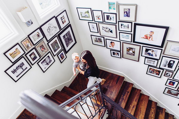 It's a perfect way to express parents' love by displaying pictures of your child's milestones on your stairwell wall.