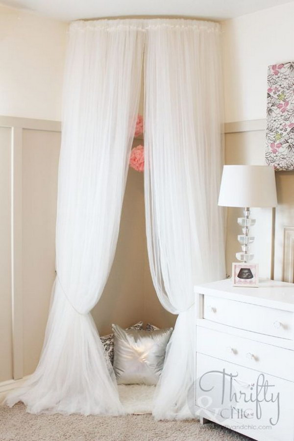 Cute Reading Nook Made out of Curved Curtain Rod and $4 Ikea Curtains