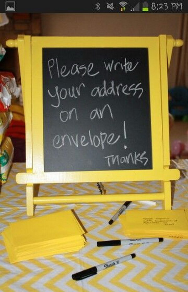Blackboard And Blank Envelopes For Guests Writing Their Names And Addresses.