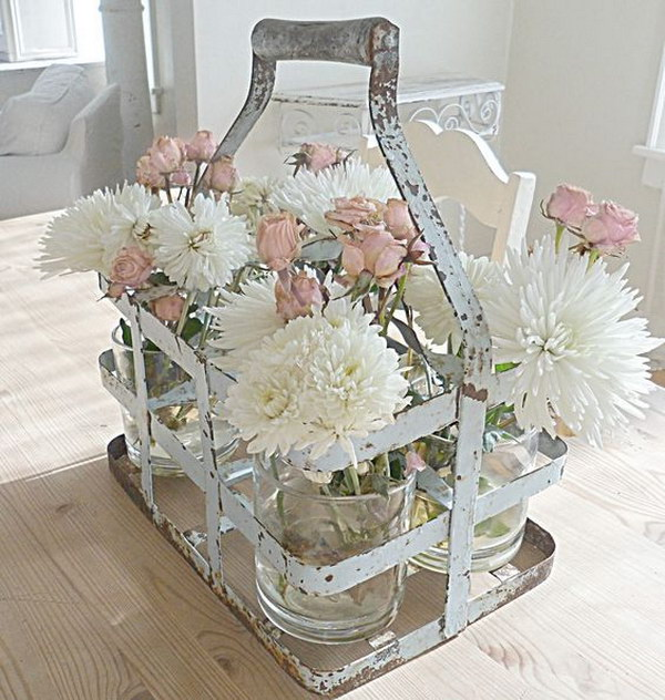 Old Milk Jug Carrier Using To Hold Mason Jars With Flowers For Table Decor