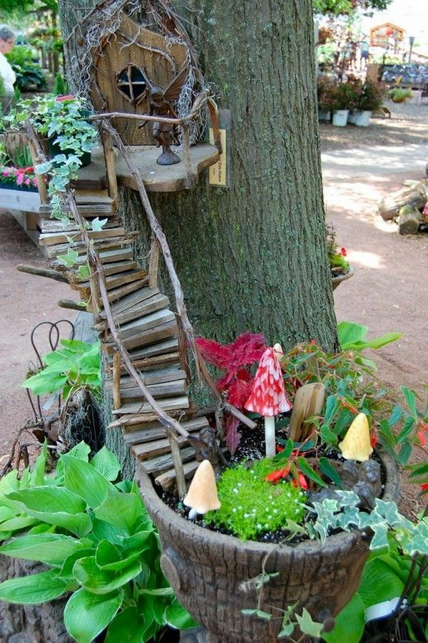 DIY Whimsical Fairy Garden With A Tree Fairy House And An Adorable Staircase