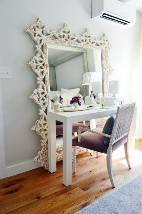 Oversized And Ornate Floor Mirror Behind Makeup Vanity.