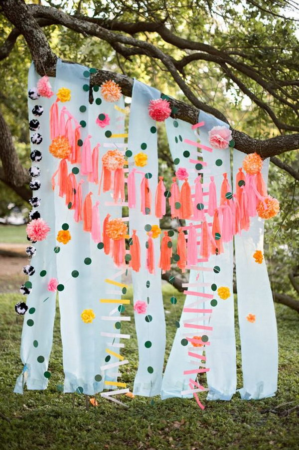 DIY Streamer And Tassels Wedding Photo Booth Backdrop.
