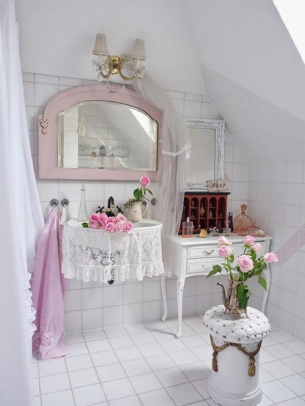 Charming Bathroom Decorated With White Tiles And Pink Accessories