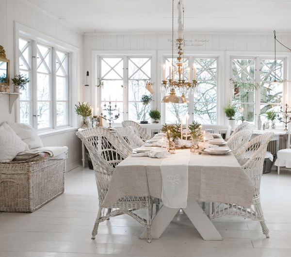Shabby Chic White Dining Room with Wicker Chair, All White Walls And Flooring.