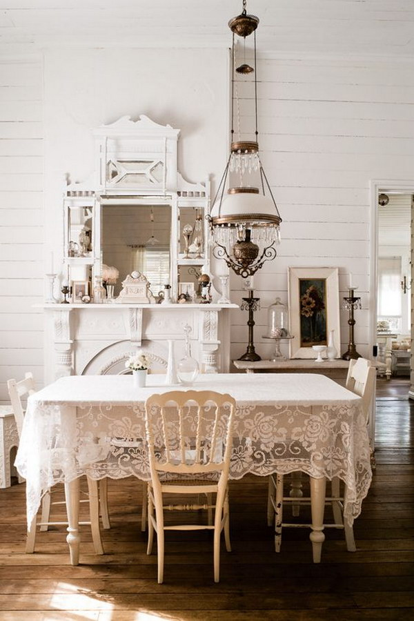 Elegant Shabby Chic Dining Room with Lace Table Cloth and Vintage Crystal Chandelier
