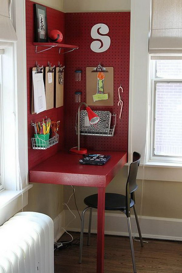 Make use of a corner for a desk backed with pegboard