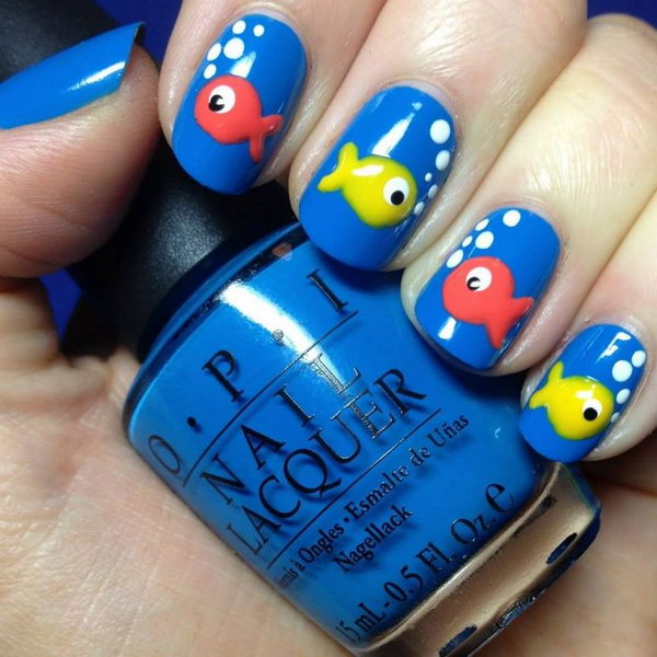 Beach Nail Design with  Colorful Fishes. I love these cute and colorful fishes on blue base nails. This nail design is perfect for a beach party or some water related activity.