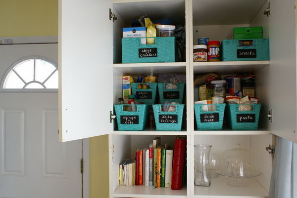 Use baskets with wooden chalkboard labels to organize your pantry cabinet