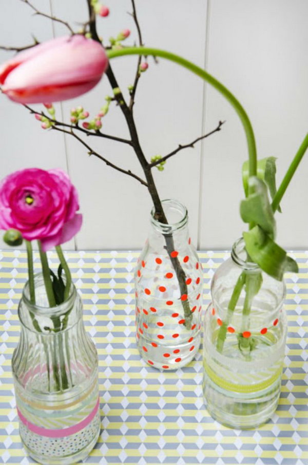 Create a DIY flower vase with old juice bottles, colourful flowers and fancy tape