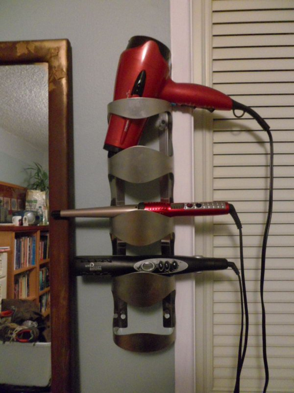 Turn your old wine bottle holder into a useful hot tools storage