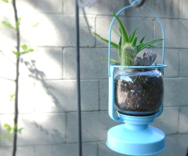 A MORKT IKEA Lantern Turned as a Fun Planter.