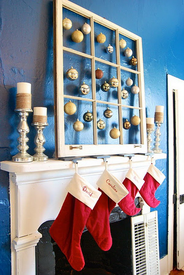 Old Window with Hanging Ornaments in Each Pane for Christmas Decor.