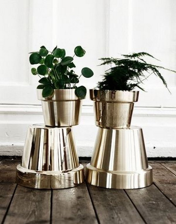 Spray Paint Your Terracotta Pots Metallic Colors to Get an Expensive Look. See details