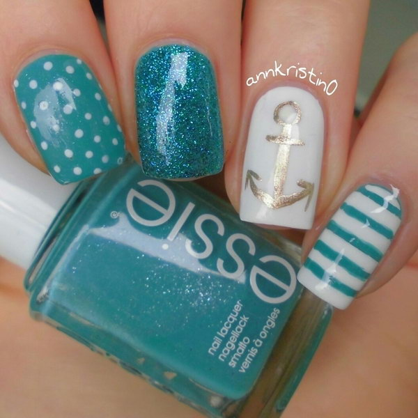 Green and White Nails with an Gold Anchor Accented.