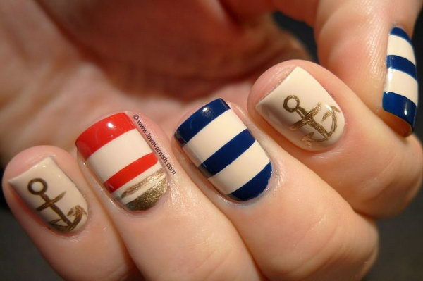 Beige Base Nails with Multi colored Strips and Gold Anchors.