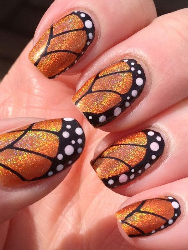 Orange Glitter Butterfly Nail Design. Get the tutorial