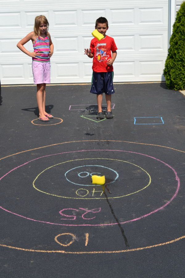 DIY Target Outdoor Games. Draw a bullseye and assign score for each circle of the target. The kids toss their sponge at the starting line. It's great to train your kids' throwing accuracy in this funny way in summer.