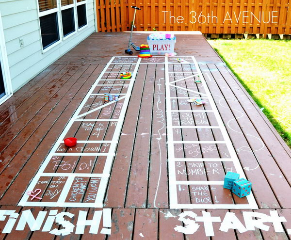 DIY Outdoor Board Games. You can make this board with tape and chalk to specify the rules for the activity according to children's suggestions and interests. They will have a lot of fun joining this interesting game on hot summer days.