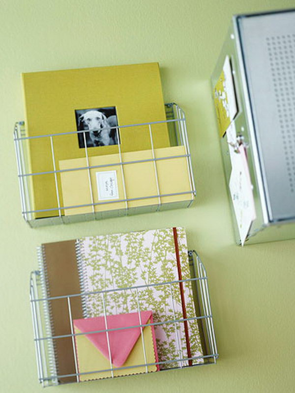 Kitchen wire racks are used in the home office as wall mounted notebook holders.