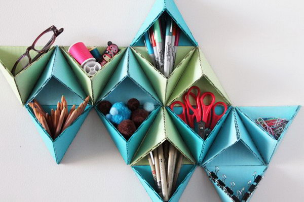 Triangular Wall Storage System. This geometric pattern not only serves as an organizer of office supplies but also super cool wall art. See how to make it