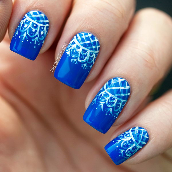 White Lace over Blue Background Nails. See more details
