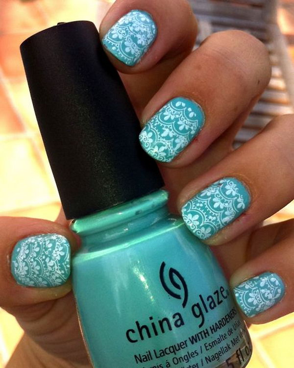 Teal and White Lace Nail Design.