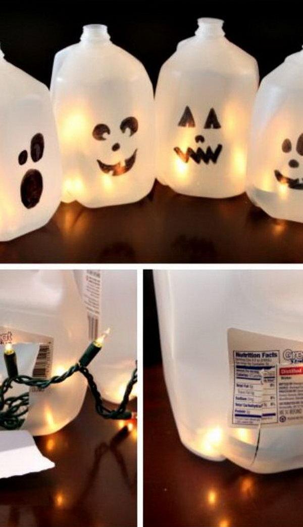 Halloween Milk Jug Ghosts. Make Halloween luminaria by filling milk jugs with lights. Easy Halloween craft idea for the kids! Tutorial via