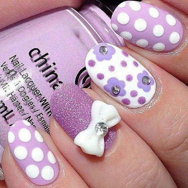 Purple Glitter Nail with Polka Dots and Bow.