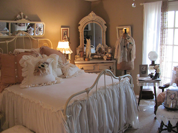 The Chic Kind Of Shabby with the Raised Arch of the Wrought Iron Bed.