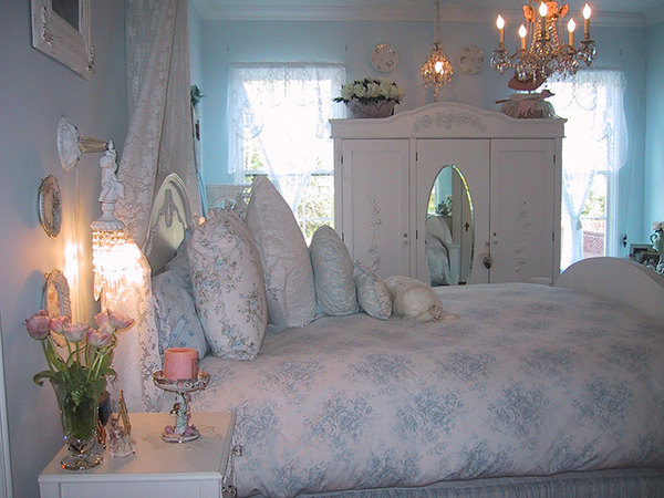 Blue Touched White Bedspread and Painted Walls Create a Shabby Chic Look.