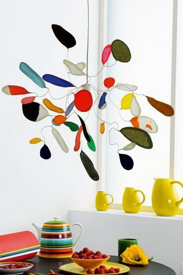Calder Inspired Mobile Made with Tissue Paper and Wire. This tissue paper mobile looks sophisticated enough to hang in any room in the house. See more directions