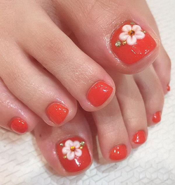 Flowers and Rinestones Accented Toe Nail Design.