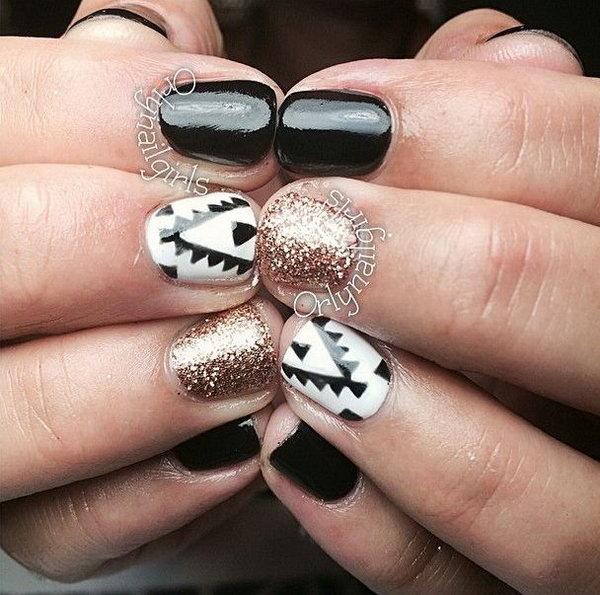 Marvelous Black and White Tribal with Giltter Nail Art Design.