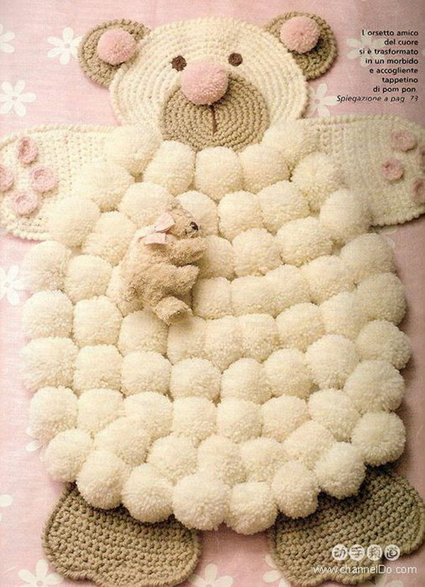 DIY Simple Crocheted Finger Pom poms Bear Rug. This will be the perfect addition to any nursery and make a wonderful way to add a little pop to your space.