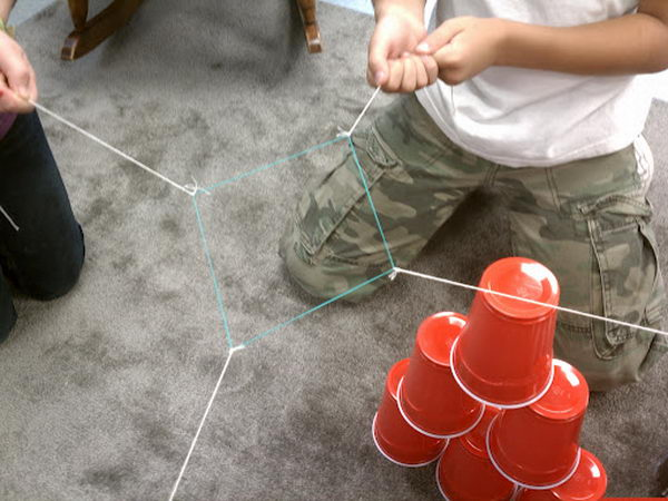 Group Structure Building. The groups need to move the cups from the assigned structure to a pyramid with three cups on bottom, then two cups then one on top. This game looks very easy to play, but full of challenge. Check out more deailed directions