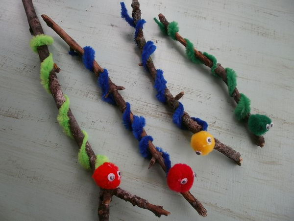 Make a Worm Using a Twig, Pipe Cleaners and Pom Poms.