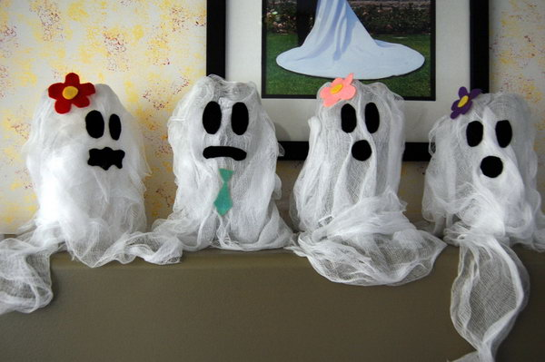 Cute Recycled Soda Bottle Ghosts for Halloween.