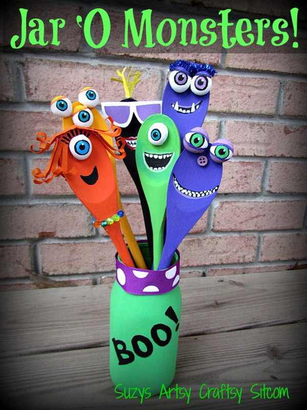 Jar O' Monsters Halloween Decor Made with Wooden Spoons and a Recycled Jar.