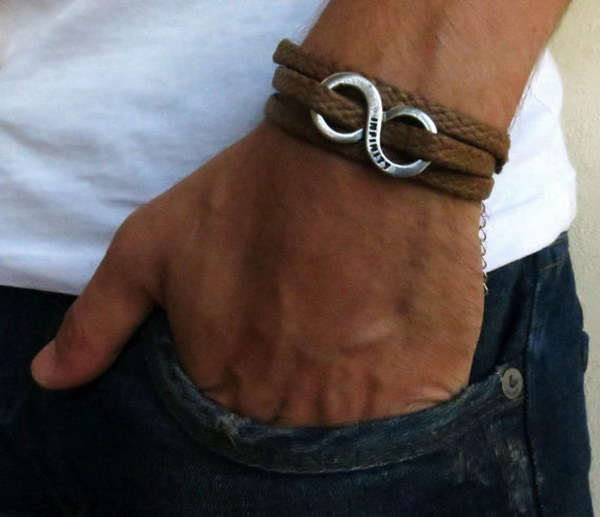 Men's Love Bracelet. The simple and beautiful bracelet combines brown fabric which wrap 3 times on hand and a silver plated infinity pendant.